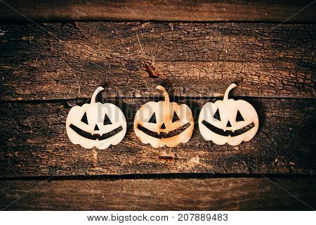 Halloween pumbkin grinning face on wooden background