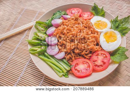Delicious Fried Noodles on Unique Bamboo Woven Table