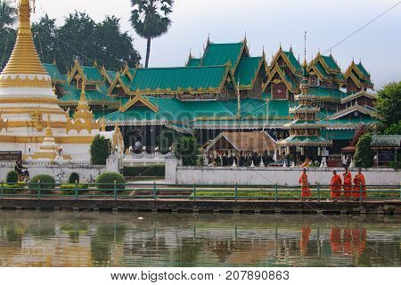 MAEHONG SORN THAILAND - JAN 222017 : thai monk standing in front of wat chong kam important traveling destination in maehong sorn northern of thailand