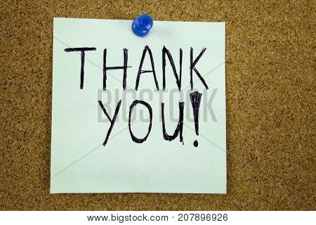 Thank you - colorful sticky notes with handwriting on cork bulletin board. Businnes concept.