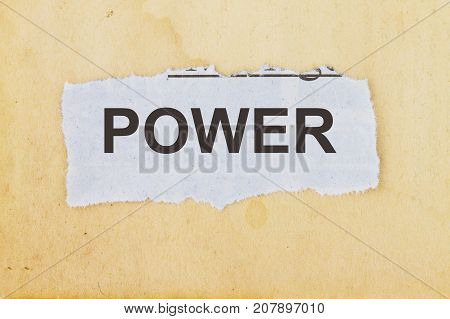Power newspaper cutout in an old paper background.