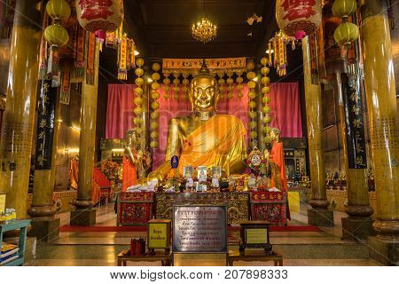 Chachoengsao Thailand - September 24 2016: Chinese style golden Buddha Image in Chinese Buddhist temple where Chinese Buddhist to worship in Chachoengsao Thailand
