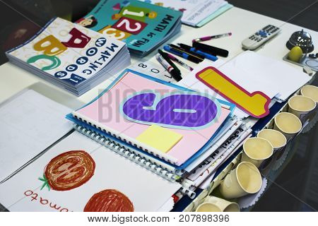 Kindergarten Students Workbooks on Teacher Table