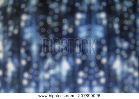 LED light on cloth curtain backdrop. Romantic round light background.