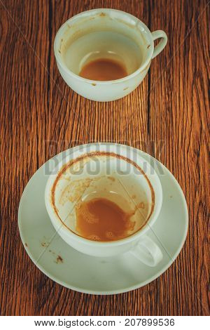 Close up top view empty cup of coffee put on brown wooden table top