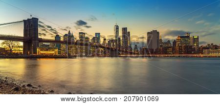 Brooklyn bridge and Manhattan after sunset, New York City