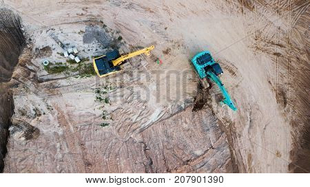 Aerial view, empty land of site construction with two excavator loader machine
