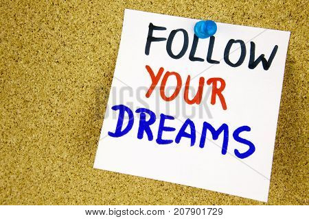 Follow your dreams on color sticker notes over cork board background businnes concept