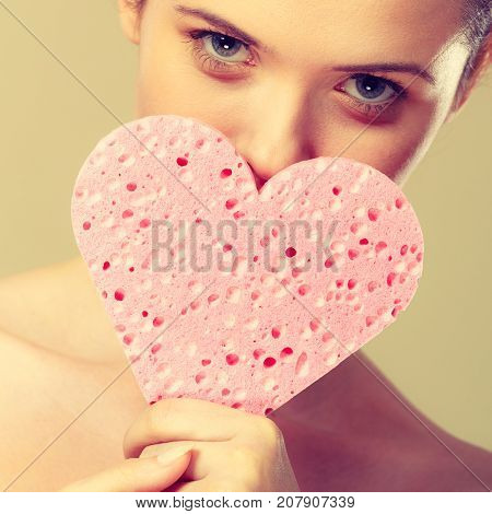 Woman Holding Pink Heart Sponge In Hands.