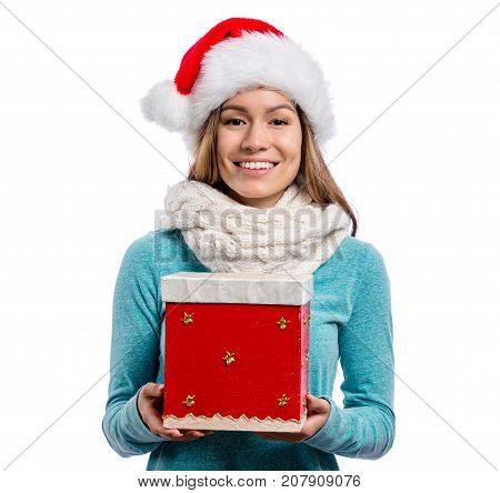 Happy young woman with Santa hat holding a Christmas present