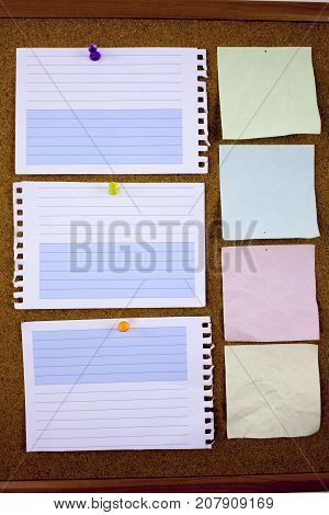 Lined note paper with sticky tape. Paper piece on white notice board, office and business stationary, blank copy space for text, template
