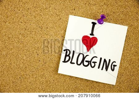 I love my Blogging written on white signboard pinned to a cork notice board Businnes Concept