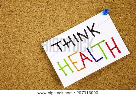 Memo note on pinned to a cork notice board as reminder Think Health Concept