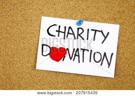 charity donation phrase handwritten on sticky note pinned to a cork notice heart symbol instead of O concept
