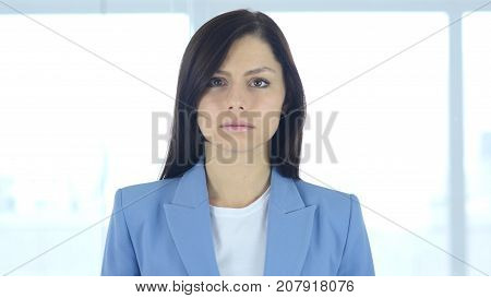 Portrait of Upset Sad Young Businesswoman in Office