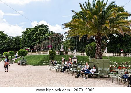 Paris France - Jule 11 2017: Tourists and Parisians relaxing in the Luxembourg Gardens (Jardin du Luxembourg) one of largest public park in Paris.