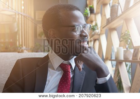 Horizontal Closeup Of Young Handsome African American Businessman Pressing His Chin With Fist While