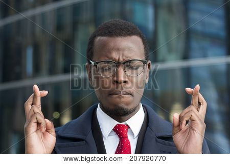 Horizontal Headshot Of Young African Businessman Pictured In Urban Environment Feeling Worried And U