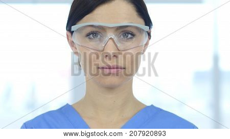 Close Up Of Reseach Scientist, Doctor Wearing Protective Glasses