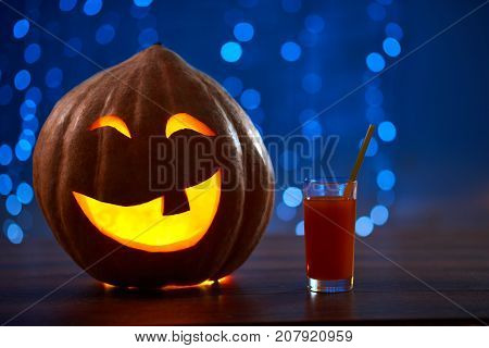 Shot of a Halloween pumpkin with a candle inside in a mysterious dark room copyspace party celebration event evening night scary mystery concept.
