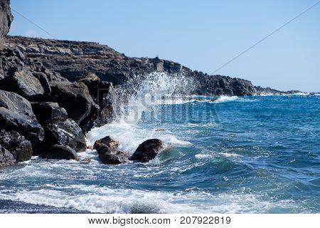 beautiful wild rocky beach with black sand. Tenerife island. atlantic ocean. outdoor shot.