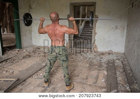 Shulder Exercise With Barbell In Shelter