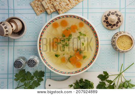 light soup with potatoes and carrots on chicken broth