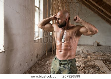 Serious Man Standing In Ruins