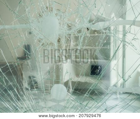 A damaged glas door after a burglary