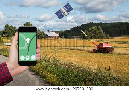 Control of the combine harvester by satellite communication. Smart farming concept