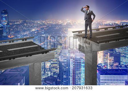 Businessman ready to overcome the broken bridge