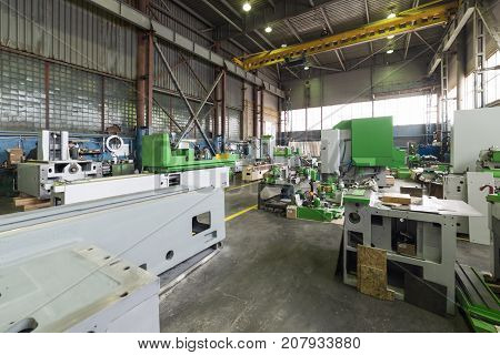 New metalworking machine in modern workshop. Modern machine-building production.