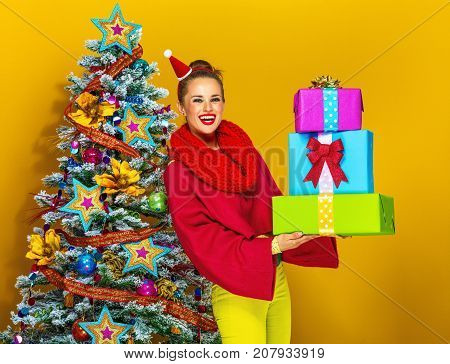 Smiling Stylish Woman With Pile Of Christmas Present Boxes