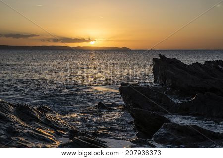 Sunrise At Hannafore Point With Rocks In Foreground And Beautiful Sky, Cornwall, Uk