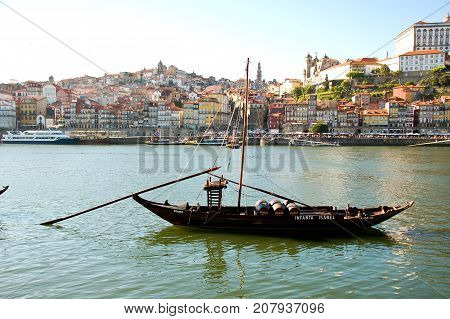 31 may 2013-oporto-portugal-old boats carrying oporto wine along the douro river