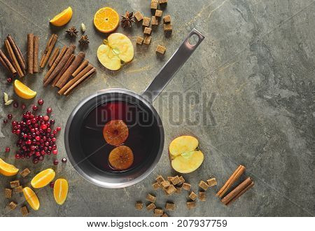 Mulled wine recipe concept mulled wine ingredients set on a table in the process of cooking view from above space for a text