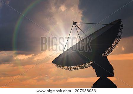 Silhouette Of Satellite Dish Or Radio Antenna At Sunset.