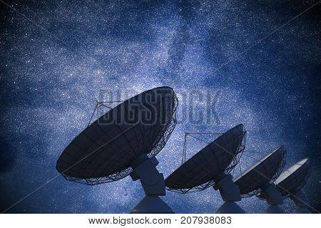 Array Of Satellite Dishes Or Radio Antennas Against Night Sky. S