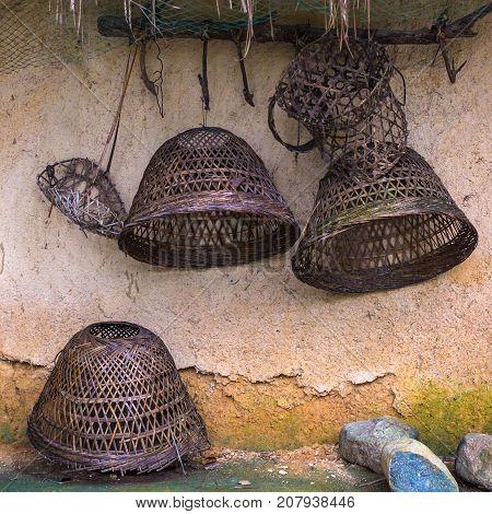 Rustic utensils in the jungle. Sanya Li and Miao Village. Hainan, China.