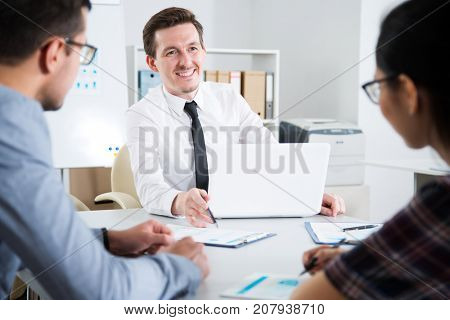 Businessman with colleagues at a presentation in the office