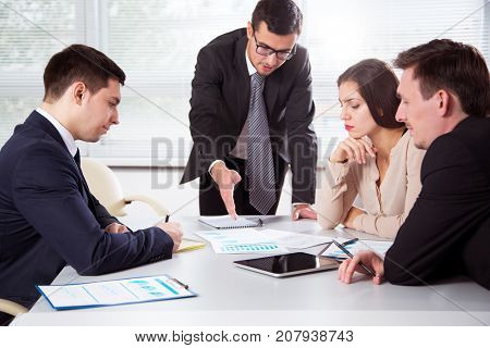Group of business people at a meeting in the office