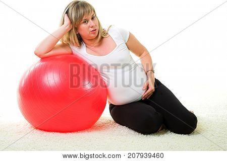 Pregnant woman doing exerxises with gymnastic ball