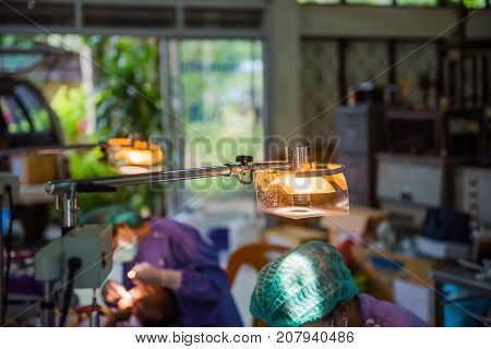 Lamps in the dental room and The doctor cares for the patient background.