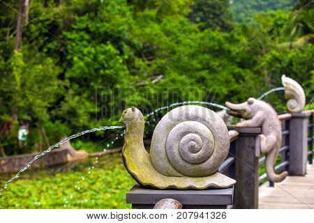 Fountain in the form of snail. Yalong Bay Tropic Paradise Forest Park, Hainan, China.