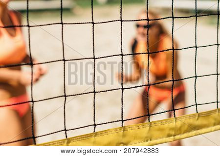 Beach Volleyball Game Women playing volleyball outdoors color image