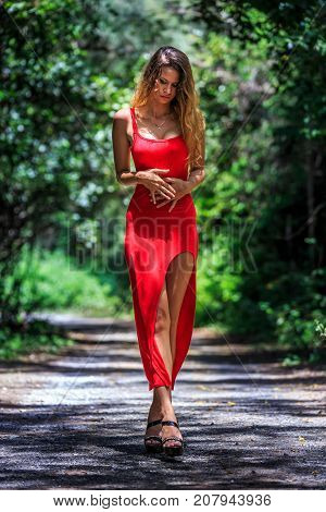 Young Woman Walking On The Tropical Road
