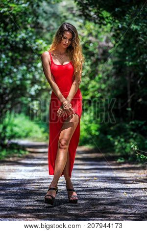 Young Woman Posing On The Tropical Road