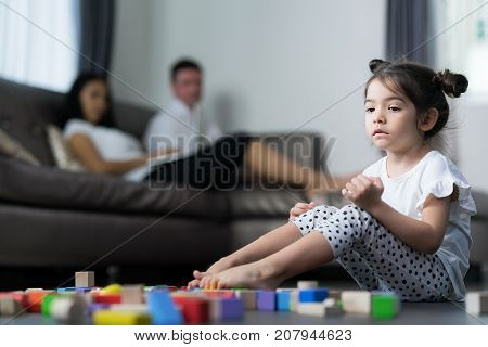 Baby cry and sit in living room with her mom and mother kid girl and family concept.