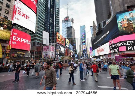 NEW YORK CITY - AUG. 29 : Unidentified people on the Times Square in Manhattan on August 29 2017 in New York City NY. Times Square is a major tourist destination and entertainment center.