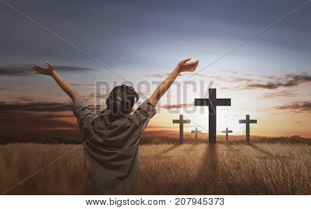 Back View Of Woman With Open Palm And Cross